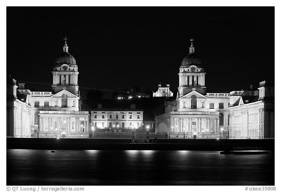 Old Royal Naval College, Queen's house, and Royal observatory with laser marking the Prime meridian at night. Greenwich, London, England, United Kingdom (black and white)