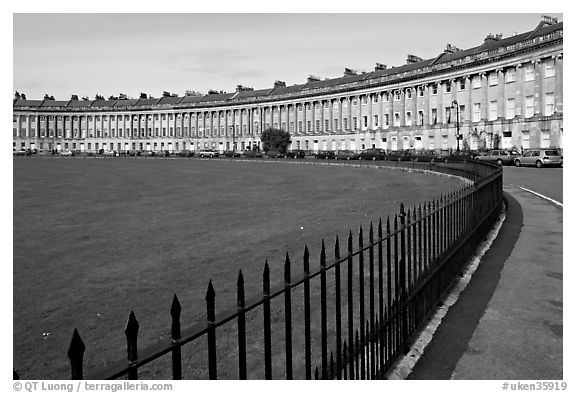 Fence, lawn, and Royal Crescent. Bath, Somerset, England, United Kingdom (black and white)