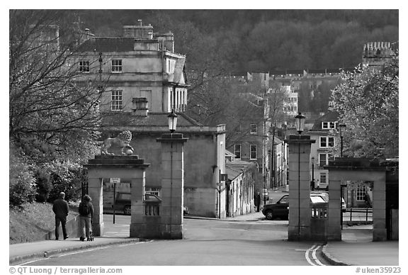 Gate at the entrance of Royal Victoria gardens, and street. Bath, Somerset, England, United Kingdom (black and white)