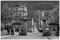 Gate at the entrance of Royal Victoria gardens, and street. Bath, Somerset, England, United Kingdom ( black and white)