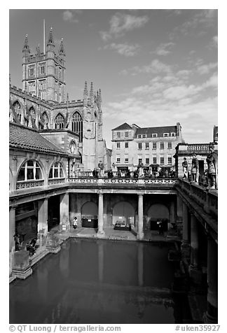 Great Bath Roman building, with Abbey in background. Bath, Somerset, England, United Kingdom (black and white)