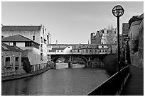 Pulteney Bridge, quay, and river Avon, late afternoon. Bath, Somerset, England, United Kingdom ( black and white)