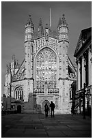 West facade of Bath Abbey with couple silhouette, late afternoon. Bath, Somerset, England, United Kingdom (black and white)