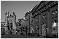 Pump Room, Roman Bath, and Abbey, dusk. Bath, Somerset, England, United Kingdom (black and white)