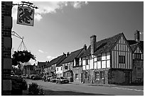 One of the four main streets  of National Trust village of Lacock. Wiltshire, England, United Kingdom ( black and white)