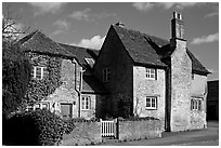 Houses with roofs made from split natural stone tiles, Lacock. Wiltshire, England, United Kingdom (black and white)