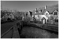 Main village street and Bybrook River, late afternoon, Castle Combe. Wiltshire, England, United Kingdom (black and white)