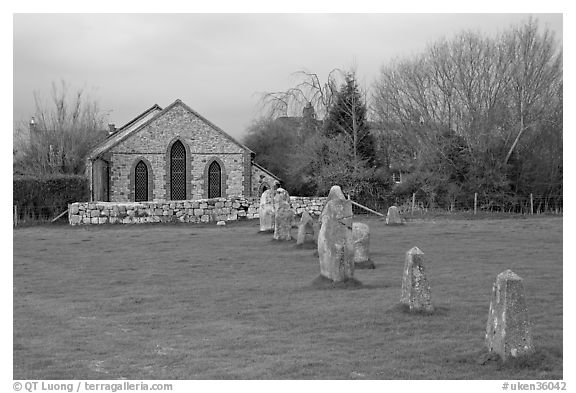 Small standing stones and chapel, Avebury, Wiltshire. England, United Kingdom (black and white)
