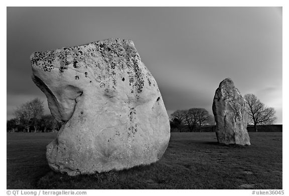 Large standing stones and brewing storm at dusk, Avebury, Wiltshire. England, United Kingdom (black and white)