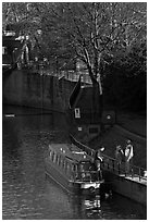 Family stepping out of houseboat onto quay. Bath, Somerset, England, United Kingdom ( black and white)