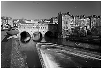Weir on the Avon River and Pulteney Bridge. Bath, Somerset, England, United Kingdom ( black and white)