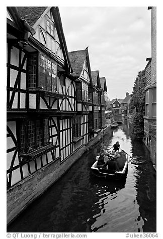 Half-timbered house, canal, and rowboat. Canterbury,  Kent, England, United Kingdom (black and white)