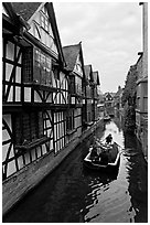 Half-timbered house, canal, and rowboat. Canterbury,  Kent, England, United Kingdom ( black and white)