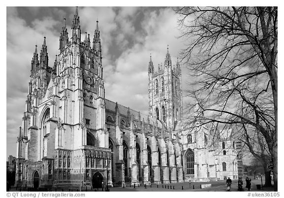 Canterbury Cathedral with people strolling on precincts. Canterbury,  Kent, England, United Kingdom (black and white)