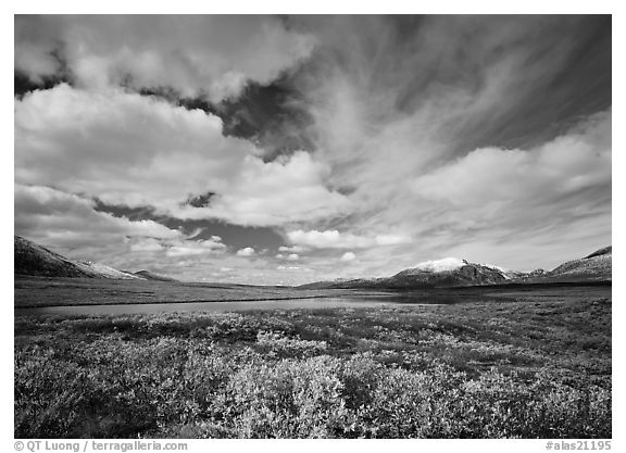 Clouds, tundra, and lake along Denali Highway in autumn. Alaska, USA (black and white)