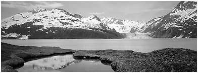 Fjord with snowy mountains. Prince William Sound, Alaska, USA (Panoramic black and white)