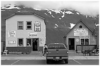 Cabins on the waterfront and red truck. Whittier, Alaska, USA (black and white)