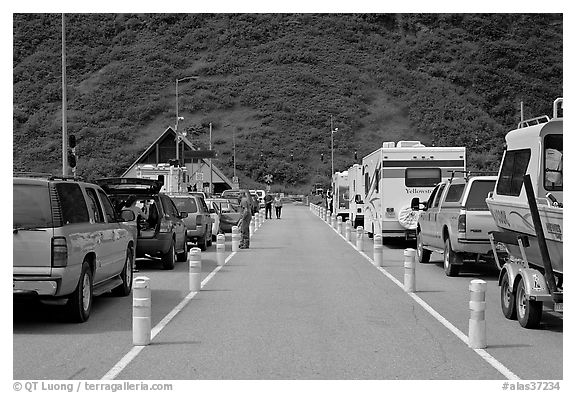 Cars and RVs lining up for the tunnel crossing. Whittier, Alaska, USA