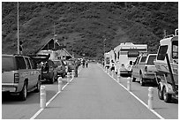 Cars and RVs lining up for the tunnel crossing. Whittier, Alaska, USA (black and white)