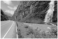 Bridalveil Falls cascading next to rood, Keystone Canyon. Alaska, USA ( black and white)