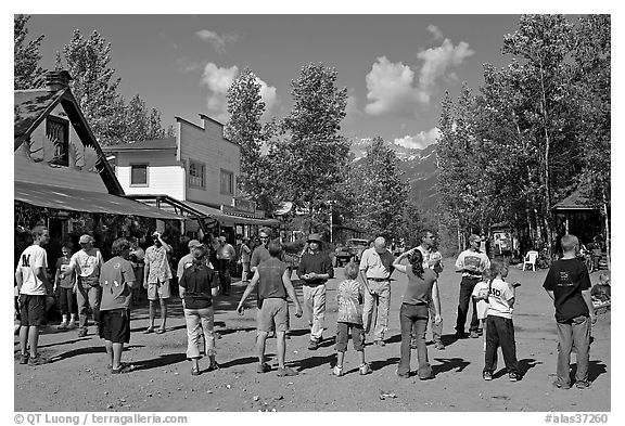 Egg throwing contest on main street. McCarthy, Alaska, USA (black and white)