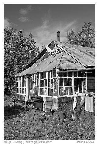 House with antlers and american flag. McCarthy, Alaska, USA (black and white)