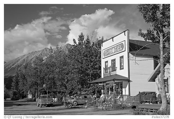 Hotel, main street, vintage car, and truck. McCarthy, Alaska, USA (black and white)