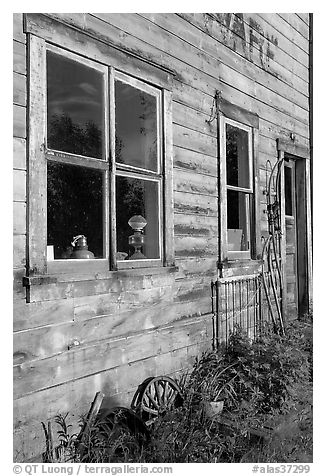 Windows and doors of old wooden building. McCarthy, Alaska, USA (black and white)