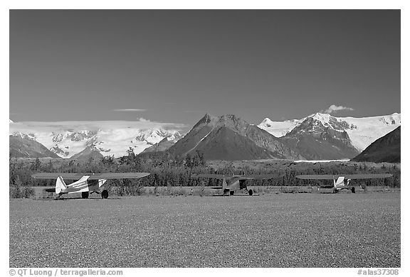 Bush planes on McCarthy airfield  and Wrangell range. McCarthy, Alaska, USA (black and white)