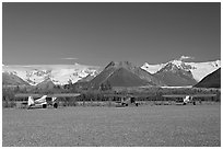 Bush planes on McCarthy airfield  and Wrangell range. McCarthy, Alaska, USA ( black and white)