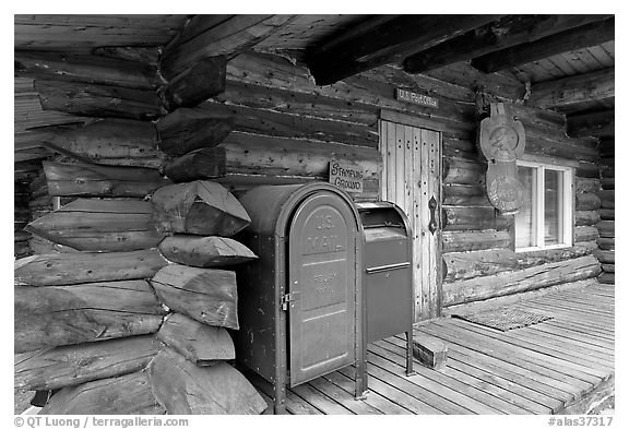 Mail boxes, log house postal office, Slana. Alaska, USA (black and white)