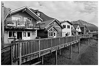 Waterfront houses on harbor. Seward, Alaska, USA (black and white)