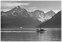 Fishing boat, mountains and glaciers. Seward, Alaska, USA (black and white)