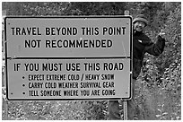 Sign with warnings about winter travel, Exit Glacier Road. Seward, Alaska, USA ( black and white)