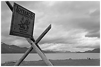 Historic Itadarod sign and Resurrection Bay. Seward, Alaska, USA ( black and white)