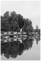 Seaplanes on the shore of Lake Hood, the largest sea plane base in the world. Anchorage, Alaska, USA ( black and white)