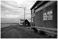 Eskimo building and US Post office on Shore avenue. Kotzebue, North Western Alaska, USA (black and white)