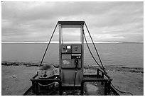 Gas pump on the beach, looking towards the Bering sea. Kotzebue, North Western Alaska, USA (black and white)