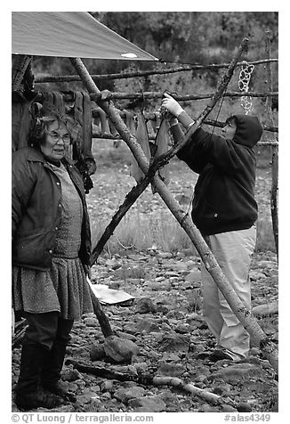 Inupiaq Eskimo women drying fish, Ambler. North Western Alaska, USA (black and white)