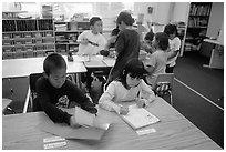 Inupiaq Eskimo kids in the classroom. Note names on table. Kiana. North Western Alaska, USA (black and white)
