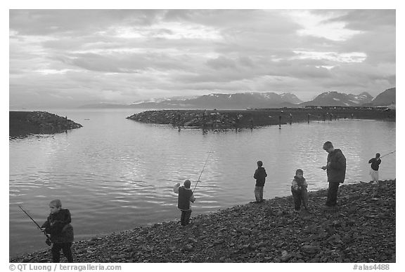 Fishing for salmon in the Spit's Fishing Hole. Homer, Alaska, USA (black and white)