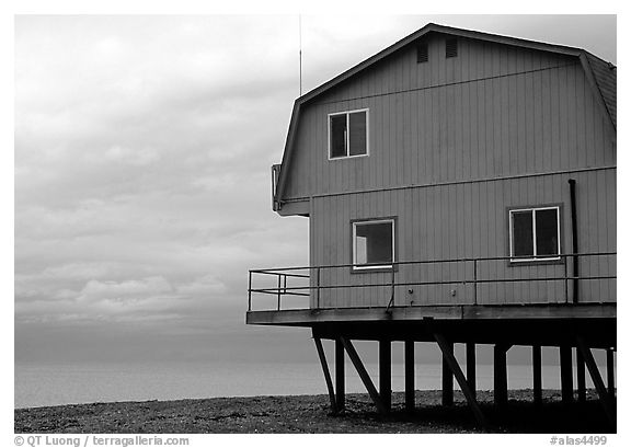 Watefront house on stilts on the Spit. Homer, Alaska, USA (black and white)