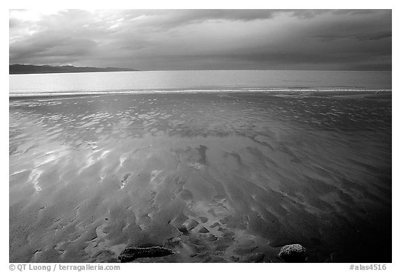 Sand patterns and stormy skies on the Bay. Homer, Alaska, USA (black and white)