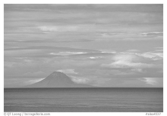 Mt Augustine, a volcano seen across the Cook Inlet. Ninilchik, Alaska, USA (black and white)