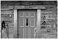 Wooden cabin door. Ninilchik, Alaska, USA (black and white)