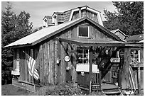 Wooden cabin in old  village. Ninilchik, Alaska, USA ( black and white)