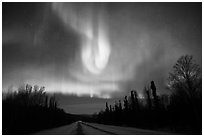 Aurora curtains above road. Alaska, USA (black and white)
