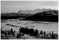 Frozen river and mountains at sunset. Alaska, USA (black and white)