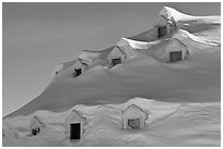 Snow-covered roof with windows. Alaska, USA ( black and white)