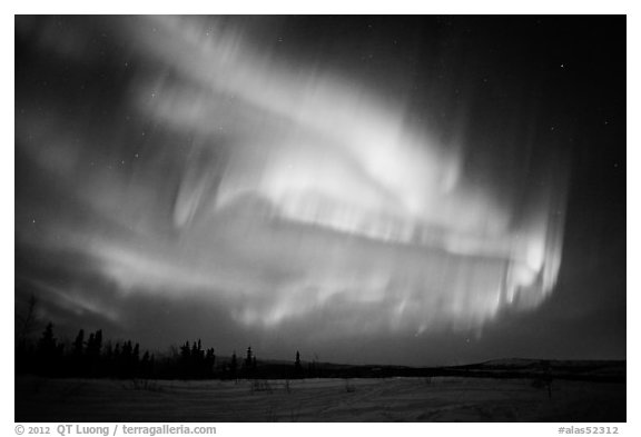 Magnetic storm in sky above snowy meadow. Alaska, USA (black and white)